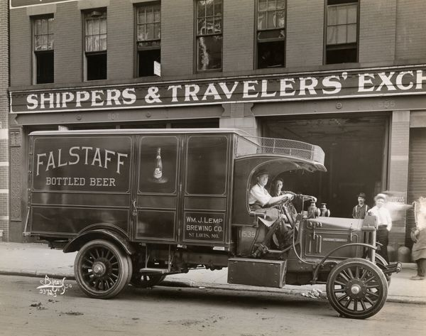 Automobile trucks. Delivery truck with driver and passenger in front of Wm. J. Hemp Brewing Co. Shippers and Travelers' Exchange building. Falstaff Bottled Beer and Wm. J. Lemp Brewing Co., St. Loui
