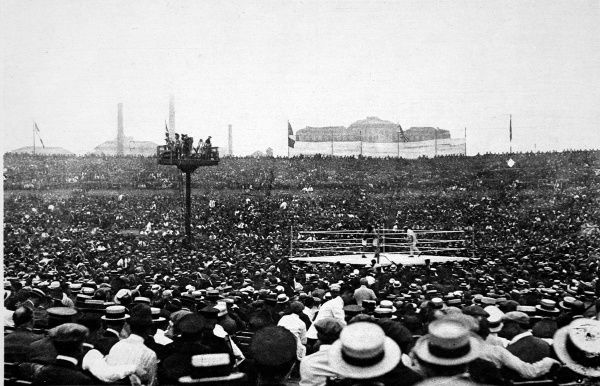 Photograph showing the 100,000 strong crowd at the fight between Georges Carpentier and Jack Dempsey for the Heavyweight Championship of the World held at Jersey City, USA, on 2nd July 1921. Date: 1921