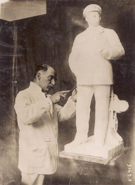 The sculptor Denys Geuch working on a statue of Edward VII, showing the late king in an informal pose, wearing sailing clothes