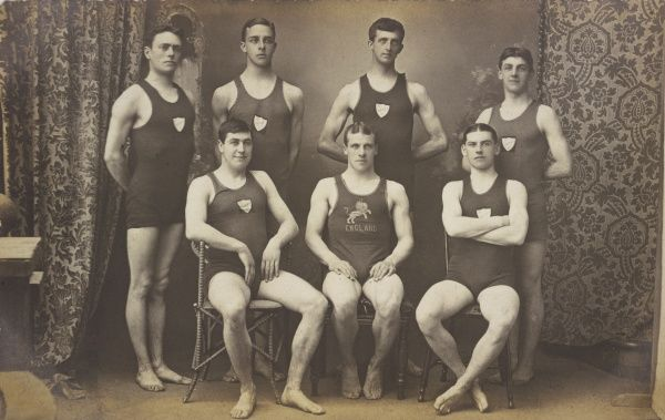 DERBY WATER POLO CLUB Seven men in swimming costumes, one with the England team's lion crest