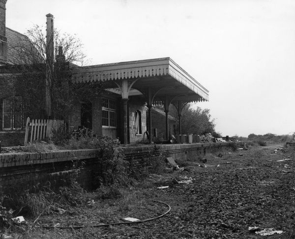 The platform of a derelict Victorian railway station near Romsey in Hampshire, England. Date: 1970s
