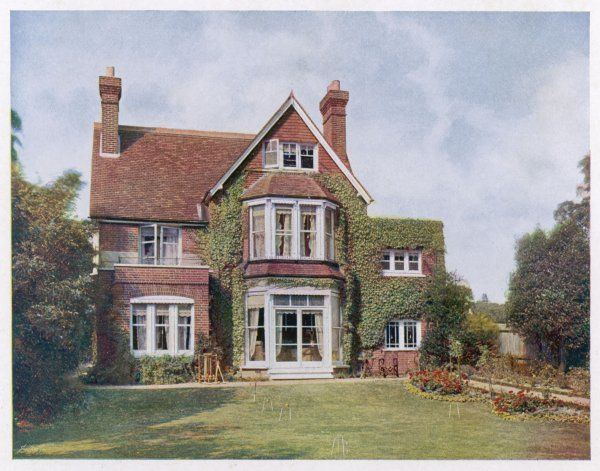 A typical middle-class home, detached, with its neatly tended garden including a croquet lawn