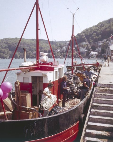 A fishing boat moored in the harbour at Dartmouth, Devon, England. Date: 1970s
