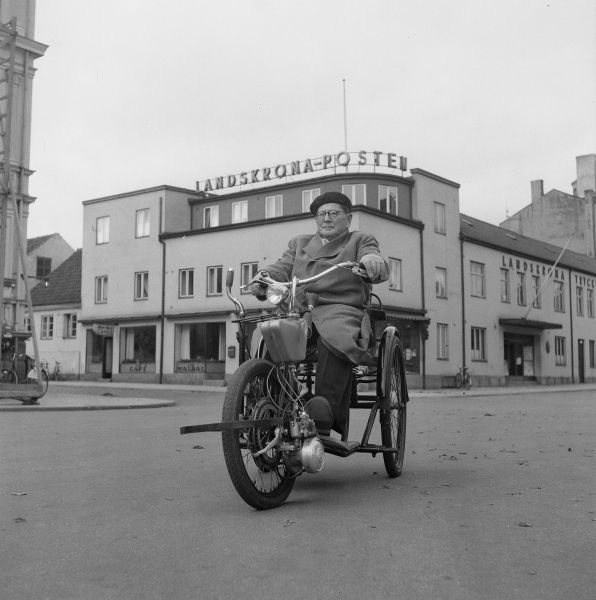 A disabled man with his motor scooter, Landskrona, Sweden 1952. Date: 1952