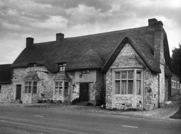 The 'Wagon and Horses', Beckhampton, Wiltshire, England, a pleasant old thatched wayside inn, mentioned in Dickens' 'The Bagman's Story'. Date: 19th century