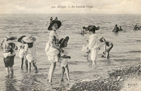 Children paddling in the surf at Dieppe, France