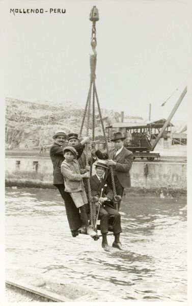 Disembarking from a ship - Mollendo, Peru. Crew members from arriving ships were lifted from their boat via a crane, the Pacific swell being too great for normal landings! circa 1930s