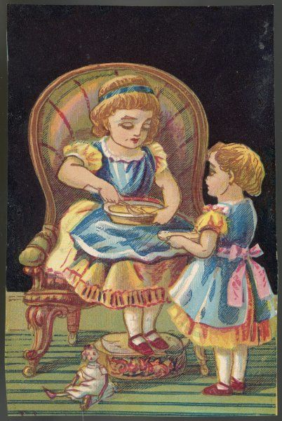 A girl, seated in an armchair and with her feet on a footstool, dishes up some pudding to her little sister. Their doll has been abandoned in favour of sweet things