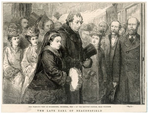 BENJAMIN DISRAELI Earl of Beaconsfield Meeting Queen Victoria at High Wycombe station on her visit to Hughenden, December 1877