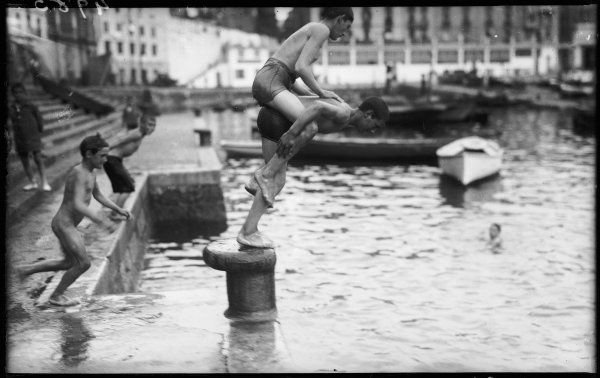 Boys piggie back dive bombing at Biarritz, France!