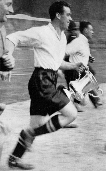 Photograph of the Everton Captain and centre-forward, Dixie Dean (1907-1980), running around Wembley Stadium after the F