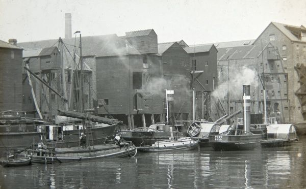 View of the docks in Hull (Kingston upon Hull), Yorkshire, with fishing vessels and smoke houses, where the fish was smoked