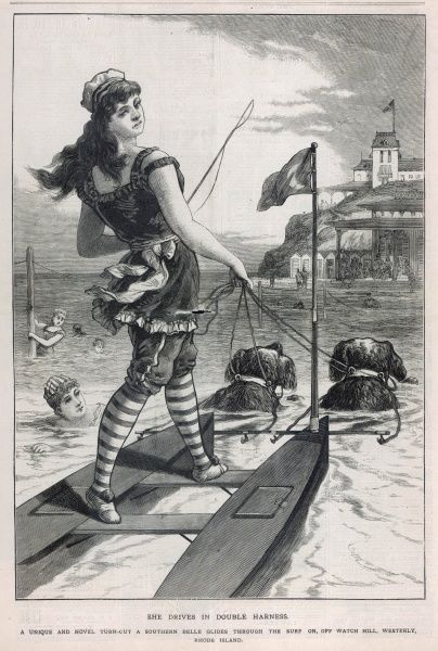 At Westerly, Rhode Island, a young lady goes for a spin in her catamaran, drawn by two very large dogs, probably Newfoundlands