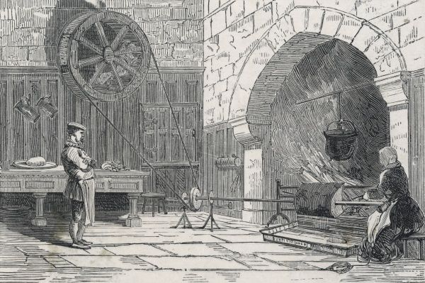 Turnspit with dog-wheel in front of the kitchen fire