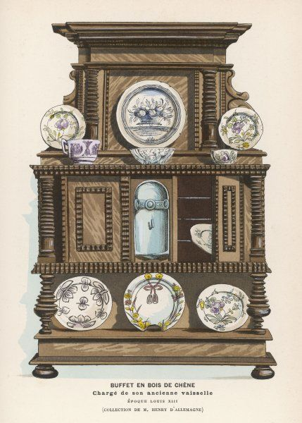 An oak dresser from a doll's house, with tableware. The bowl is half the size of a thimble