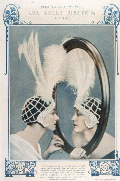 DOLLY SISTERS Jenny and Rosie, American stage performers, with what looks like a mirror, but isn't