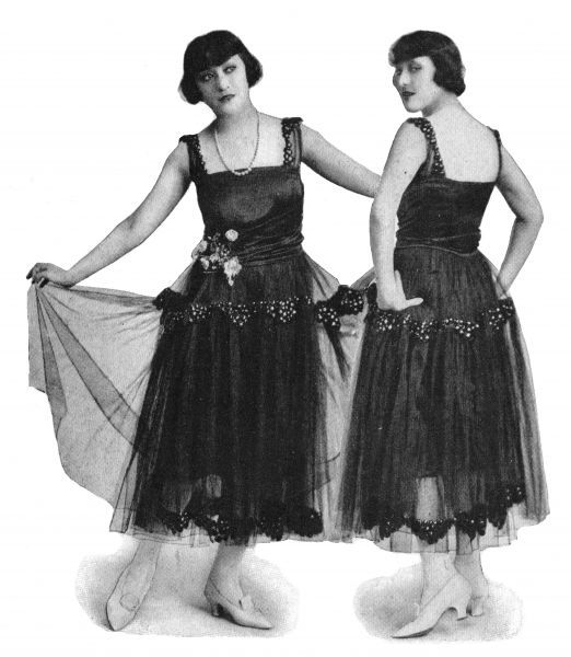 The Dolly Sisters modelling smart evening gowns of black tulle and jet with satin bodice, USA, circa 1915 circa 1915