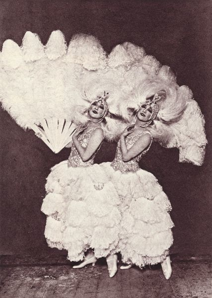 Photograph showing 'The Dolly Sisters' clad in an feathered outfit at the Palace Theatre, Paris, 1924