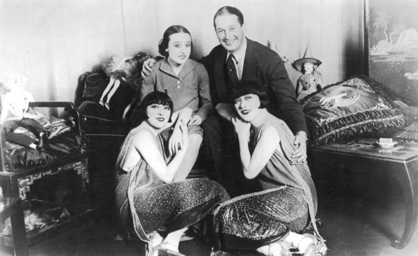 The Dolly Sisters with Maurice Chevalier and Yvonne Valle, resting during a perfomance of Paris en Fleurs, Casino de Paris, Paris, 1925 1925