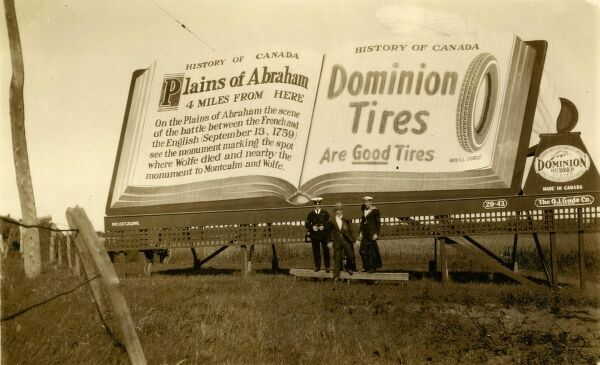 Dominion Tyres advert and a sign for the Plains of Abraham in Quebec City, Canada