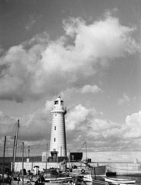 The lighthouse on the pier at Donaghadee, a popular summer holiday resort in County Down, Northern Ireland. Date: 1950s