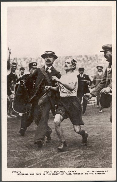 Pietri Dorando of Italy wins the marathon from Windsor to the Olympic stadium, but because he is assisted during the final metres he is disqualified