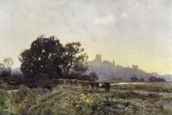 A distant view of the town from the meadows. Date: circa 1910