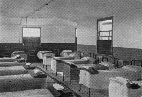 View of a dormitory at the East Harling, Norfolk, branch of the National Institutions for Persons Requiring Care and Control, an organisation privately run by the Rev Harold Burden to house 'feeble minded' children. The site, at Kenninghall
