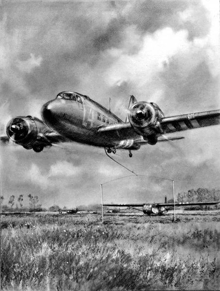Illustration showing a Douglas Dakota, C-47 Skytrain, swooping down with a hook trailing to pick up a Waco glider, Normandy, France, 1944. This system of launching and towing a glider was designed as a time-saving measure, so that tug aircraft