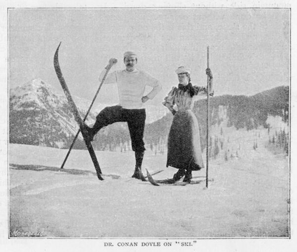 SIR ARTHUR CONAN DOYLE In comical pose on skis in the Alps, with female companion