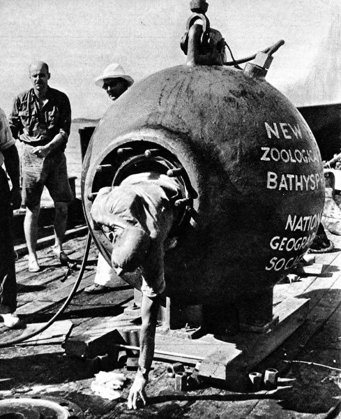 Photograph of Dr. William Beebe and his two-ton iron bathysphere off St. George, Bermuda, 11th August 1934. Dr. Beebe and his photographer, Otis Barton, had just returned from a descent of 2510 feet below sea level