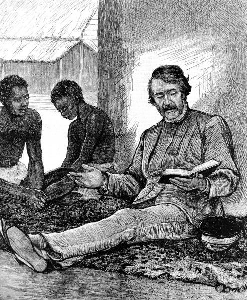 Engraving of Dr. David Livingstone (1813-1873), the Scottish missionary and explorer, reading the Bible to some of his African helpers