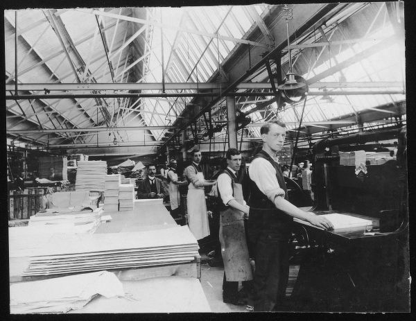 Interior of the Drayton Paper Works, Fulham, Lonodn, showing workers sorting reams of freshly produced paper