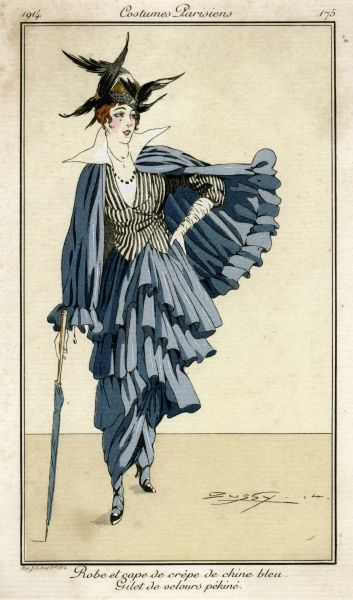 Brimless hat & feathers, dress of tiered tunic & tango skirt, gathered cape with flounce, blouse with wired collar, wrap over long sleeved waistcoat in a vertical stripe & gloves. Date: 1914