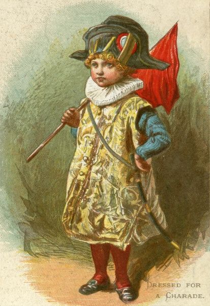 A small boy dressed in a confusing variety of historical fancy dress items presents himself for an elaborate game of charades