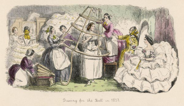 Lady dresses for the ball in the age of crinoline. Assisted by an army of ladies maids an inflatable cage crinoline is lowered into place while being blown up with bellows