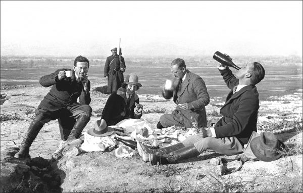 A group of British diplomatic (or foreign service) personnel fool about during a picnic, possibly in Iran. Their attendant guard seems totally unfazed by the high jinks! Photograph by Ralph Ponsonby Watts