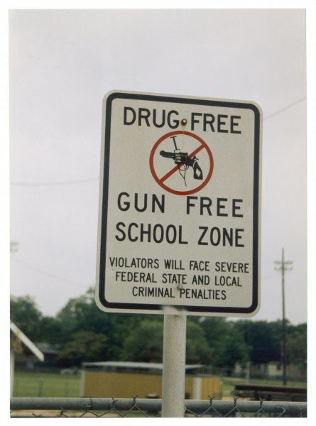 Drug free and gun free zone sign outside a school in San Antonio, Texas