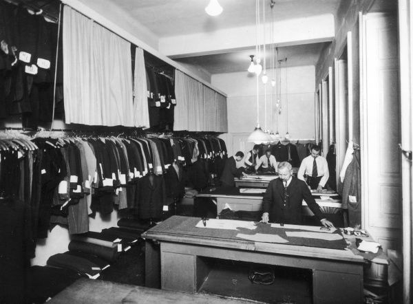 ERNST DRYDEN Tailors at work in Knize & Co, a shop which Dryden did many designs for