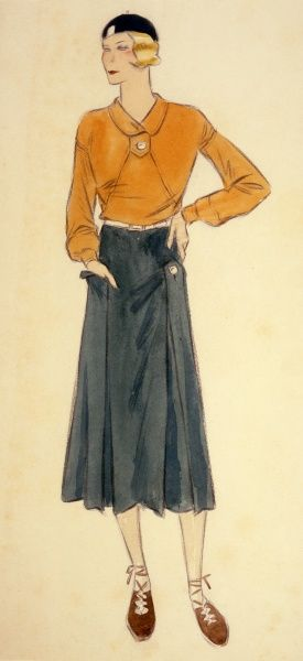 A sporty look - an orange top worn with a green skirt and beret