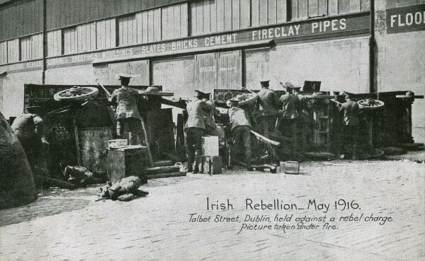 Dublin Easter Rising - view behind the barricade - British troops under fire on Talbot Street, holding a barricade against a rebel charge - May 1916