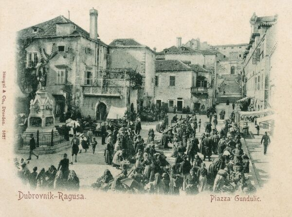 Market stalls on the Piazza Gundulic - Dubrovnik (Ragusa), Croatia - on the left is a monument to Ivan Gundulic (1589 - 1638) - the most celebrated Croatian Baroque poet from the Republic of Ragusa