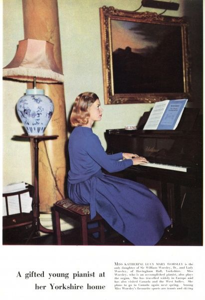 Miss Katherine Lucy Mary Worsley, the present Duchess of Kent, pictured playing the piano at her home, Hovingham Hall, Yorkshire