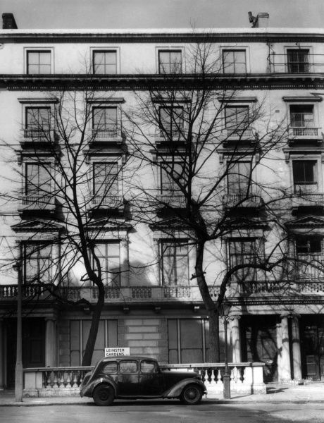These 'dummy' houses, in a terrace, 23 & 25 Leinster Gardens, Bayswater, London, were built to conceal a gap in the terrace, when the inner Circle Line tube was built. Date: 1950s
