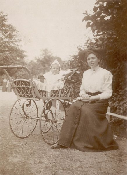 A Dutch baby in its pram, with mother or nanny