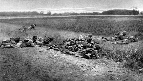 On duty with the allies in France: Indian Infantry taking cover while attacking
