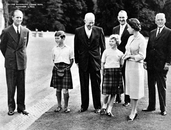 Photograph showing (from left to right): Prince Philip, Prince Charles, Dwight D Eisenhower, Princess Anne, John Eisenhower and Queen Elizabeth II, on the lawn of Balmoral Castle, August 1959