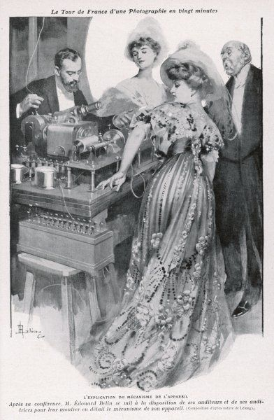 Edouard Belin demonstrates his instrument to transmit pictures at a distance (an early example of fax technology) at the Salle du Theatre Femina, Paris, France. (2 of 2)