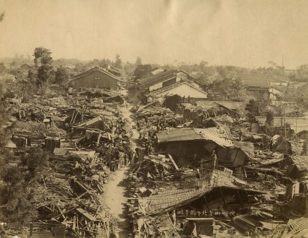 A street and houses in Japan showing substantial damage from, possibly, an earthquake