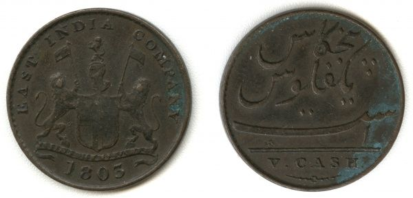 An East India company coin dated 1803, during the Madras Presidency. Bearing the coat of arms of two lions with flags and a shield, surmounted by a helmet, and the motto below: Ausp. Regis & Senat. Anglia (under the auspices of the King and Senate of England)